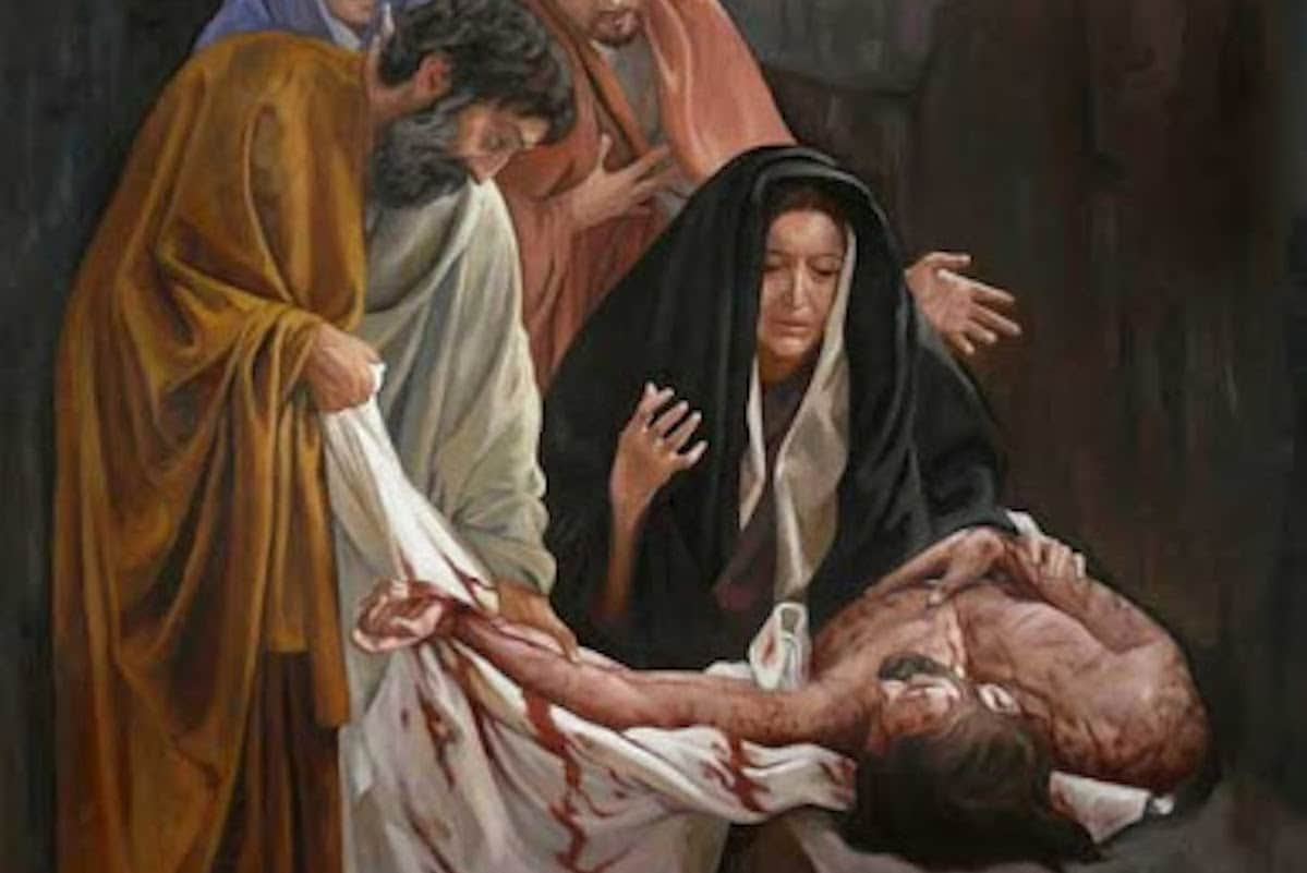 Jesús es depositado en el sepulcro en la XIV Estación del Viacrucis.